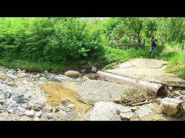 Через сильні зливи у с. Розкопинці на Сокирянщині затоплені городи і зруйновані дороги